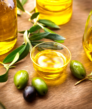 Olives and olive oil. Bottle of virgin olive oil Stock Photo
