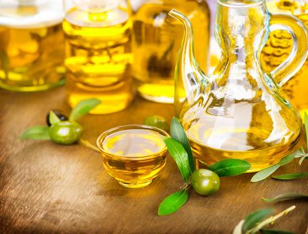 oil tree: Olives and olive oil. Bottle of virgin olive oil Stock Photo