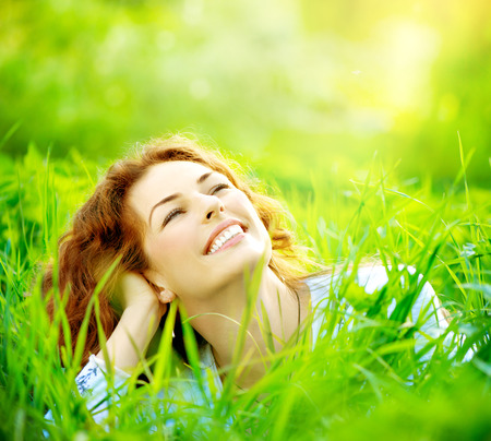 Beautiful young woman outdoors enjoying nature Standard-Bild