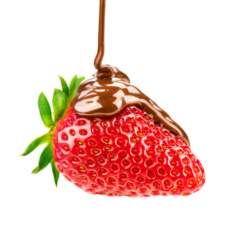 chocolate sauce: Melted chocolate pouring on fresh ripe juicy strawberry