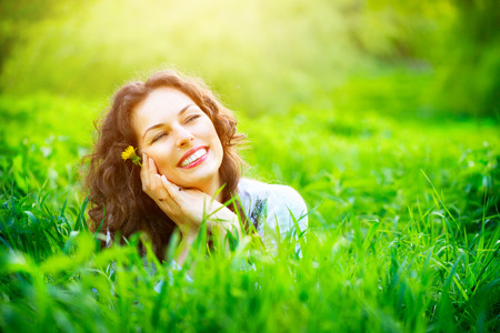 enjoy: Beautiful young woman outdoors enjoying nature Stock Photo
