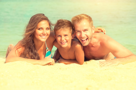 beaches: Happy family having fun at the beach. Joyful family Stock Photo