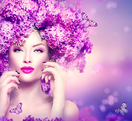 makeup: Beauty fashion model girl with lilac flowers hairstyle