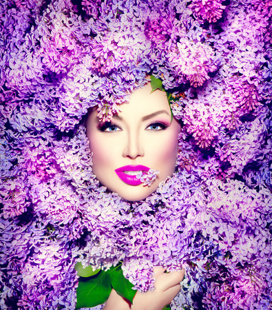 Beauty fashion model girl with lilac flowers hairstyle photo