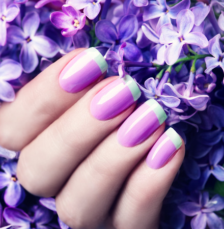 nails woman: Manicured nails. Violet with green colors art manicure Stock Photo
