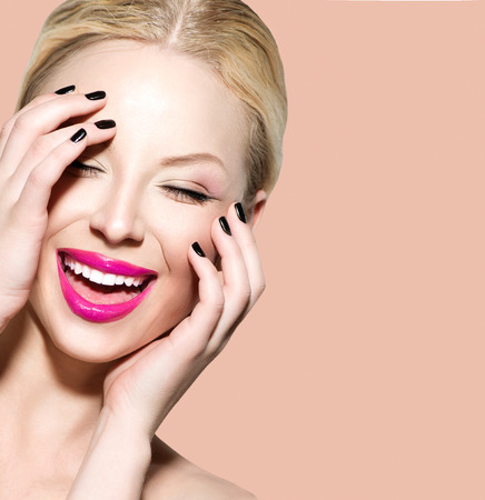 facial: Laughing beautiful young woman with clean fresh skin Stock Photo
