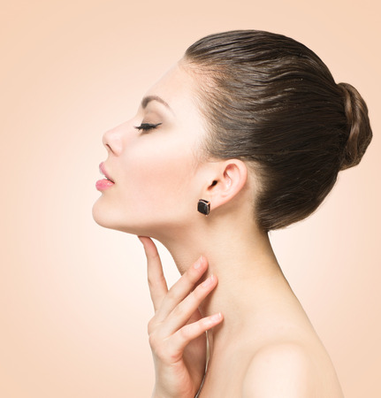 beauty product: Beauty portrait. Beautiful spa woman touching her face