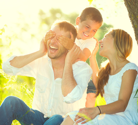 mother: Happy joyful young family having fun outdoors Stock Photo