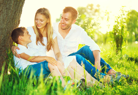 fun: Happy joyful young family having fun outdoors Stock Photo
