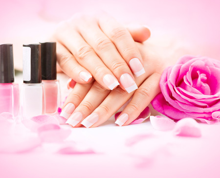 french manicure: Manicure and hands spa. Beautiful woman hands closeup