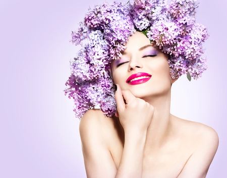 spring fashion: Beauty fashion model girl with lilac flowers hairstyle
