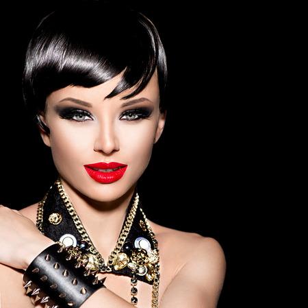 Beauty punk fashion model girl. Rocker style brunette photo