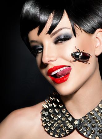 Sexy punk fashion model girl. Rocker style brunette photo