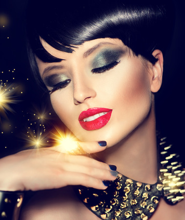 dark red: Beauty fashion model girl with bright makeup and golden accessories