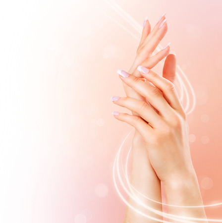 pink nail polish: Beautiful female hands. Spa and manicure concept