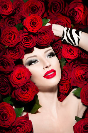 sexy glamour: Sexy model girl with red roses flowers hairstyle Stock Photo