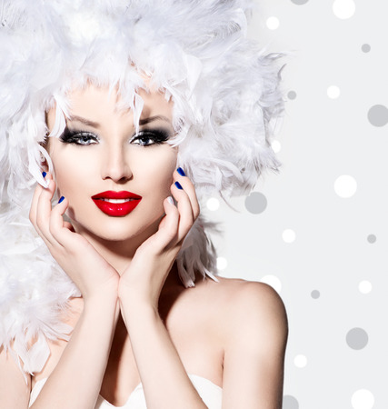 Beauty fashion model girl with white feathers hair style 스톡 콘텐츠