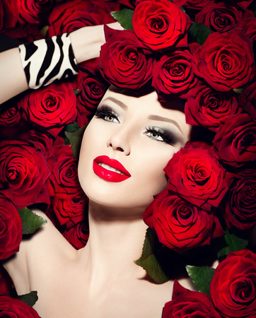 sexy model: Sexy model girl with red roses flowers hairstyle Stock Photo