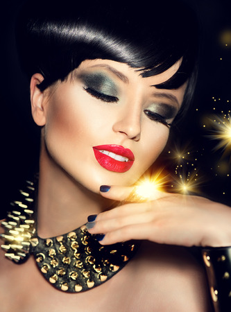 Beauty fashion model girl with bright makeup and golden accessories photo