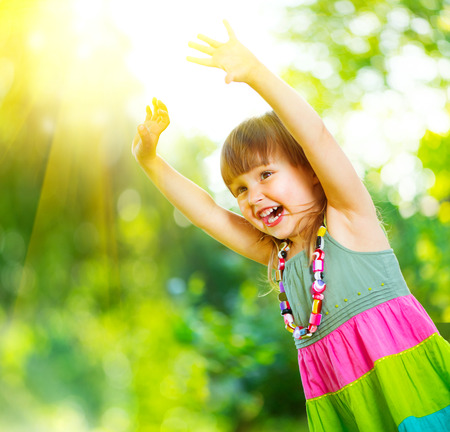 little girl child: Happy little girl having fun outdoors