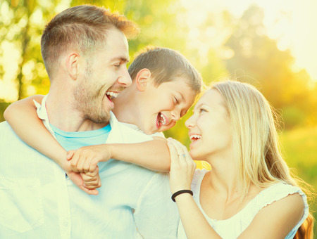 family garden: Happy joyful young family having fun outdoors Stock Photo