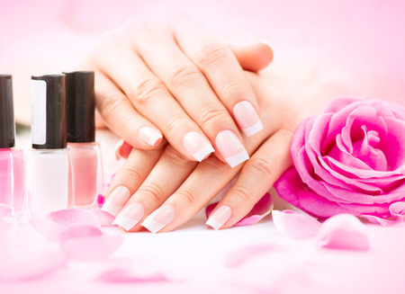 manicured: Manicure and hands spa. Beautiful woman hands closeup