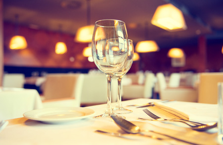 setting: Served dinner table in a restaurant. Restaurant interior