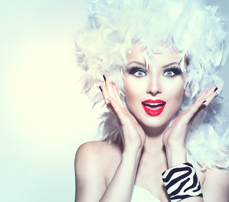 Surprised woman in white feather wig holiday make up