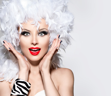 Funny surprised woman in white feather wig 스톡 콘텐츠
