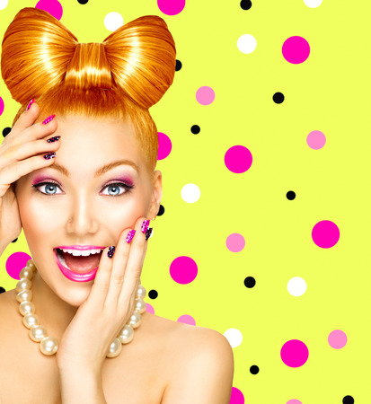 Beauty fashion happy model girl with funny bow hairstyle