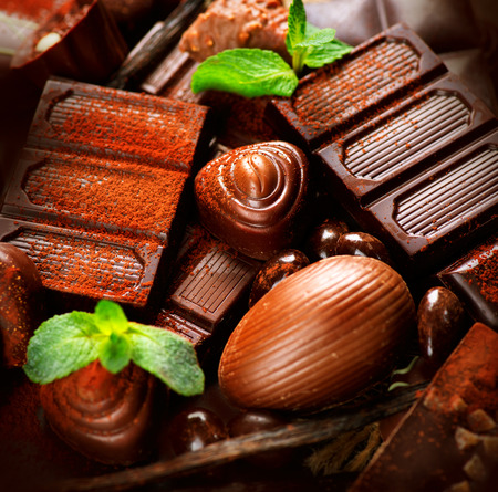 chocolate treats: Chocolates background. Praline chocolate sweets Stock Photo