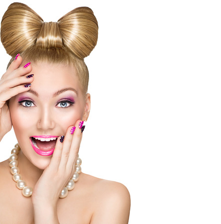 pink nail polish: Beauty surprised model girl with funny bow hairstyle