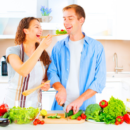 kitchen  cooking: Happy couple cooking together in their kitchen