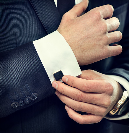 costly: Elegant young businessman wearing suit