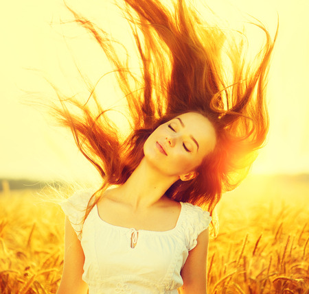 blowing of the wind: Beauty romantic girl outdoors in sun light