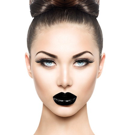 High fashion beauty model girl with black make up and long lushes 스톡 콘텐츠