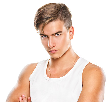 serious: Handsome athletic young man isolated on white background