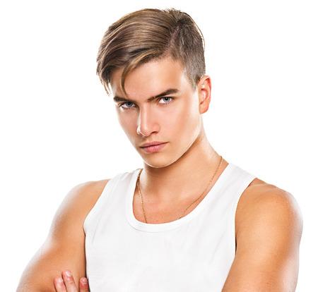 Stattlicher athletischer junger Mann isoliert auf weißem Hintergrund Standard-Bild