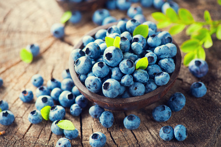 ripe: Blueberry on wooden background. Ripe and juicy fresh picked blueberries closeup