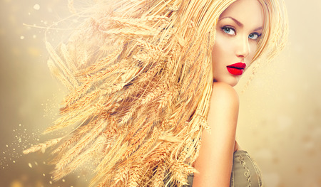 blond hair: Beauty fashion model girl with gold long wheat ears hair