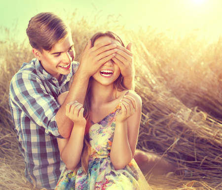 beauty girl pretty: Happy couple having fun outdoors on wheat field, love concept
