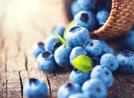 closeup: Blueberry on wooden background. Ripe and juicy fresh picked blueberries closeup