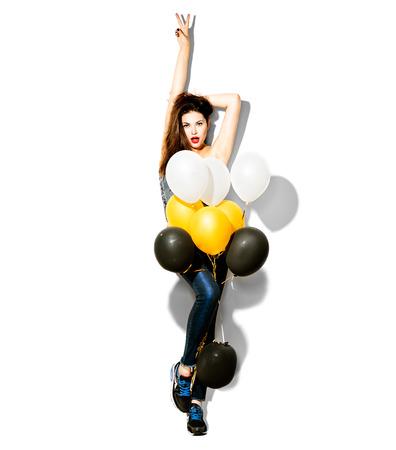 時尚: 美容時尚型的女孩全長縱向與五顏六色的氣球