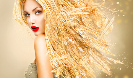 skin care products: Beauty fashion model girl with gold long wheat ears hair