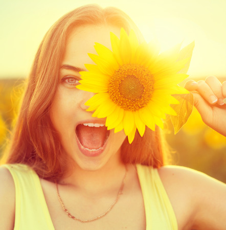 flowers field: Beauty joyful teenage girl with sunflower