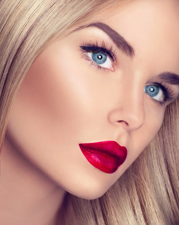 red white blue: Beautiful blonde girl with healthy blond hair and perfect makeup