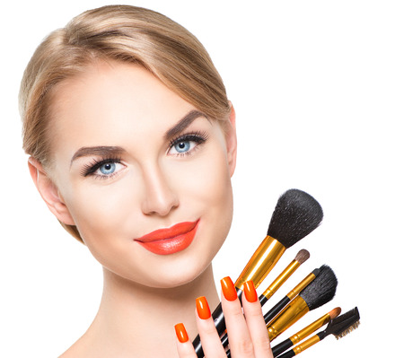 beauty woman face: Beauty woman with makeup brushes