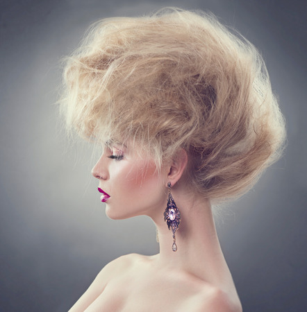 High fashion model girl with updo hairstyle