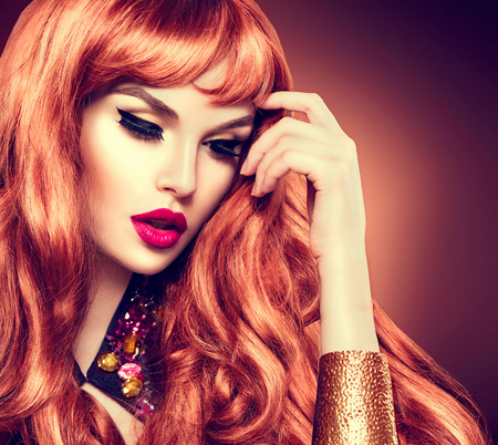 ginger hair: Beauty woman portrait. Healthy long curly red hair Stock Photo