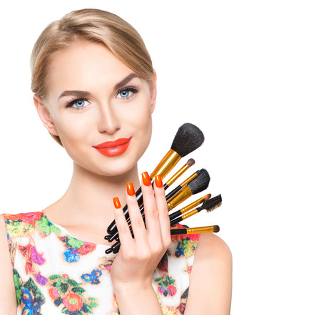 natural make up: Beauty woman with makeup brushes. Natural make-up for blonde model girl with blue eyes